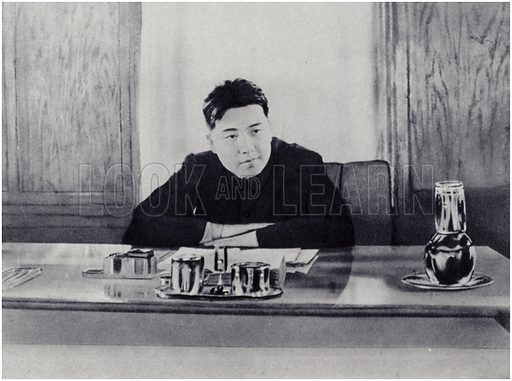 Comrade Kim Il-sung at his office at the People's Council of North Korea.