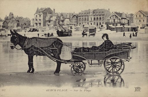 Postcard depicting a young man sitting in a cart being drawn by a donkey