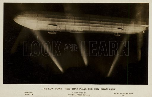The low down thing that plays the low down game; a Zeppelin caught in searchlight beams, World War I.