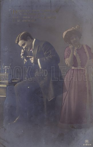 Vintage postcard of couple using telephones. Publish by Rotophot Berlin.