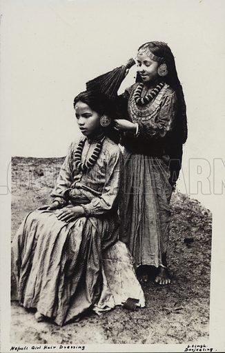 Nepali girl hair dressing. Photograph by S Singh, Darjeeling.