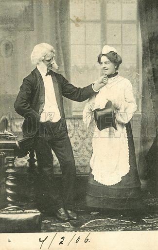 Man pinching a woman's chin
