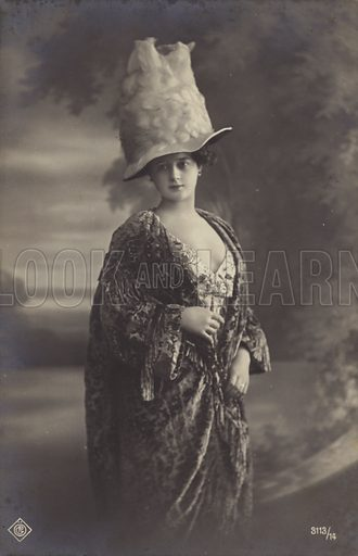 Attractive young woman, wearing a strange hat.  Postcard, early 20th century.
