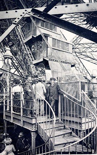 Tourists visiting the Eiffel Tower, Paris, France, c1910.