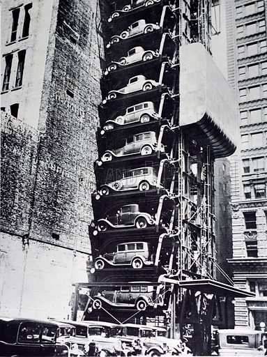 Cars in an elevator parking lot, New York City, New York, USA, 1920s.