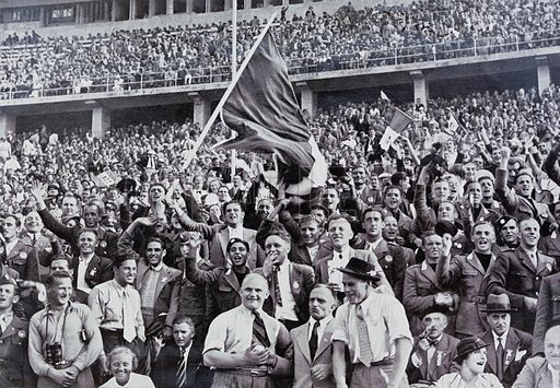 Italian fans supporting their athletes in the stadium at the Olympic Games, Berlin, Germany, 1936.