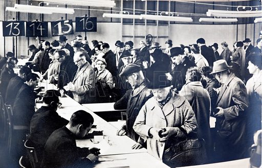 East German citizens queuing to obtain permits to visit relatives in the West.