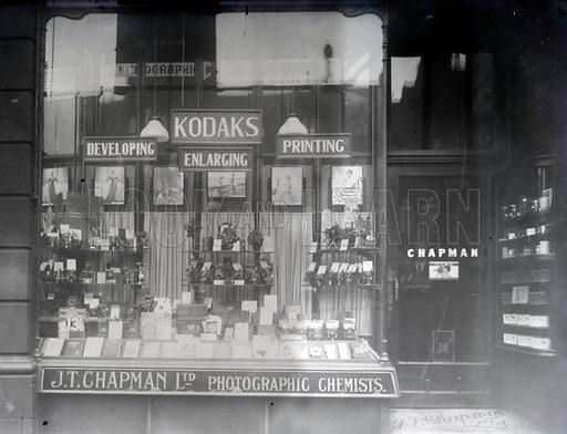 Shop window of J T Chapman Ltd, photograpgic chemists.