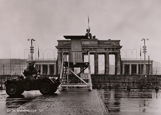 British armoured car on the border between East and West Berlin at the Brandenburg Gate. Postcard, 20th Century.
