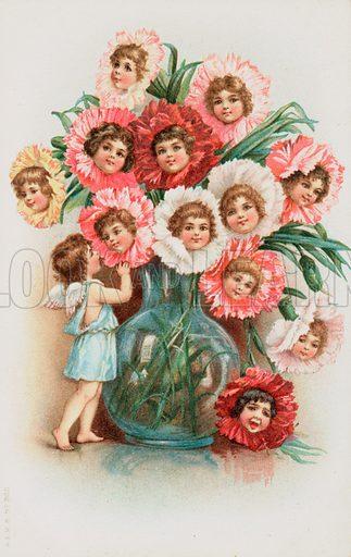 A cherub standing beside a glass vase of flowers