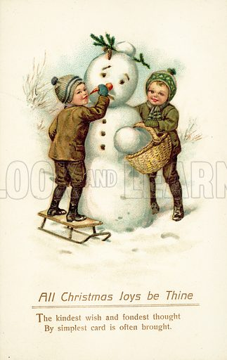 Two children making a snowman