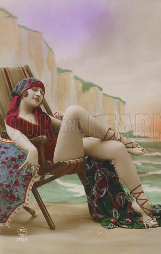 Girl in a deck chair. Postcard, early 20th century.