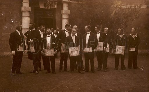 A group of masons.  Postcard, early 20th century.