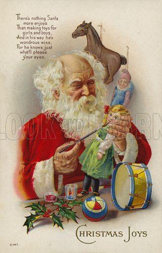 Santa Claus making a doll