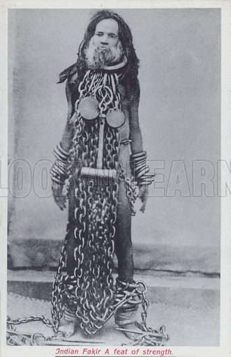 Indian fakir carrying heavy metal chains in a display of his strength