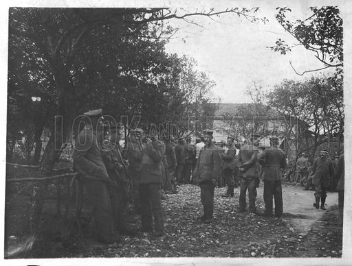 German soldiers in a village or town square. Postcard, early 20th Century.