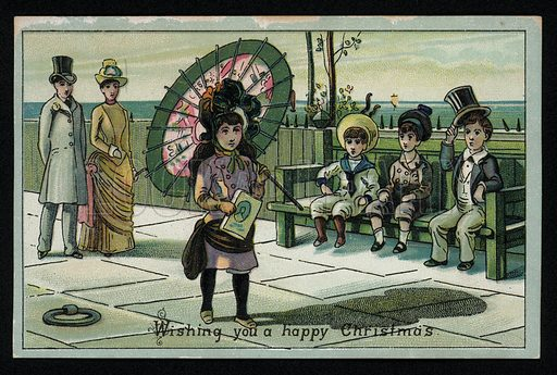 Girl with a large parasol walking along a seaside promenade, Christmas greetings card, late 19th century.