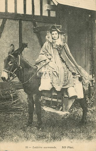 Young woman riding a donkey at a Normandy dairy. Postcard, late 19th or early 20th century.