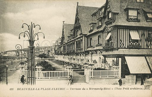 The terrace at the Normandy Hotel at the seafront on the beach at Deauville, France. Postcard, late 19th or early 20th century.