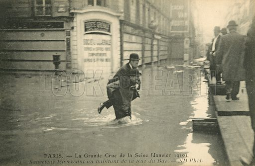 Rescuing a man crossing the Rue du Bac, flooding in Paris, January 1910. Postcard, early 20th century.