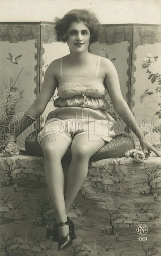 Portrait of a seated woman in her underwear. Postcard, late 19th or early 20th century.
