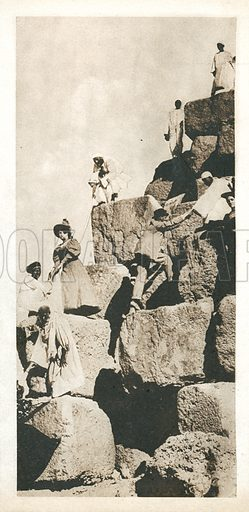 Tourists climbing the Great Pyramid at Giza, Egypt. Postcard, late 19th or early 20th century.