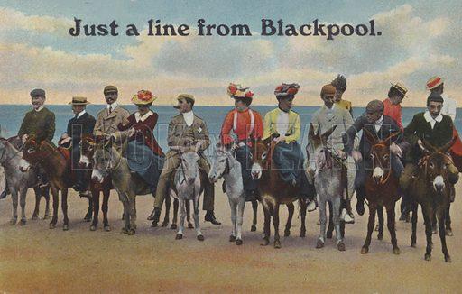 Row of people on donkeys at Blackpool beach