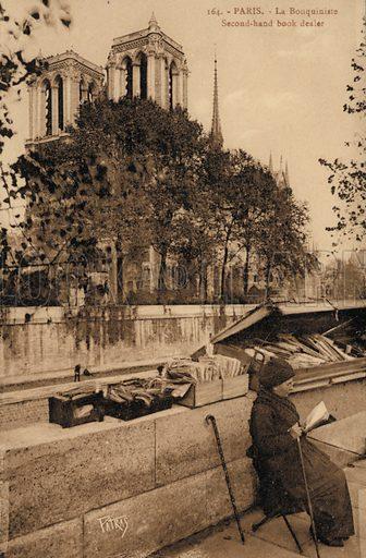 Second hand book dealer outside Notre Dame de Paris, France.