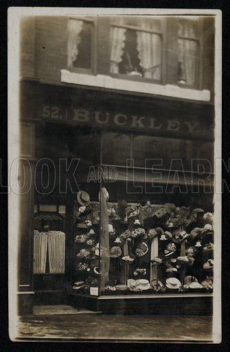 Milliner's shop window. Postcard, early 20th Century.