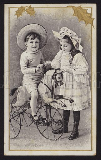 Two children playing with a horse tricycle, Christmas greetings card, early 20th Century.