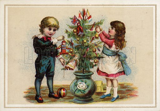 Children decorating a small Christmas tree.