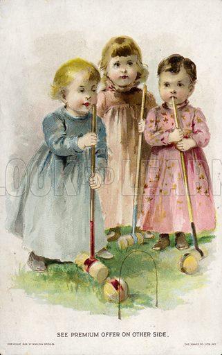 Children playing croquet.