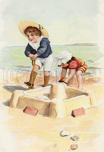 Boy and girl building sand castles