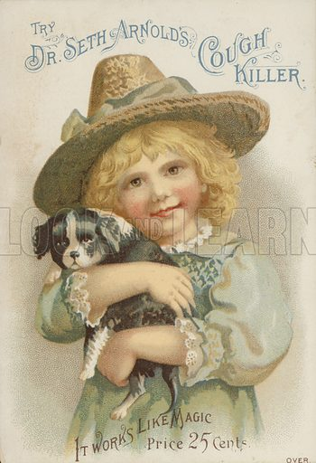 Girl in straw hat holding a puppy
