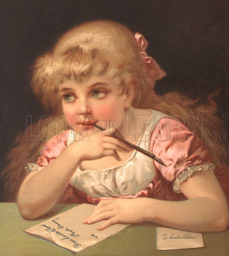 Young girl writing a letter to Santa Claus