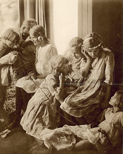 """Listening to """"The Children's Hour"""". Photograph from the Illustrated London News of 10 November 1923."""