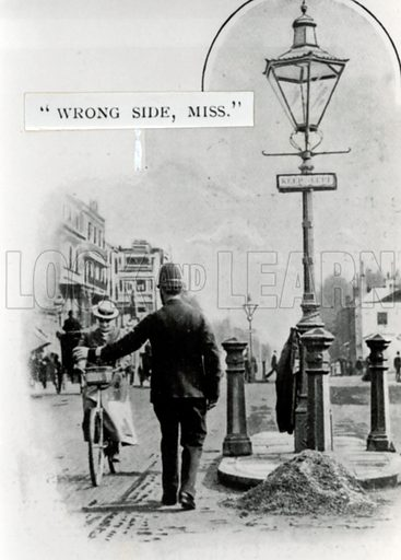 Policeman gives advice to female cyclist. Caption added.