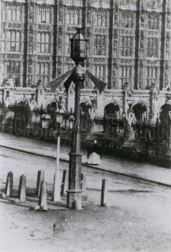 A traffic signal on a London street.
