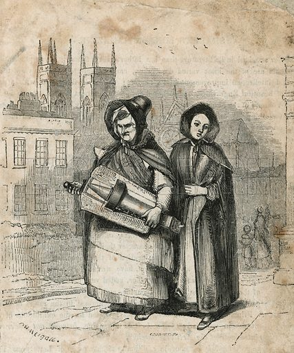 Hurdy gurdy being carried by mother and daughter.