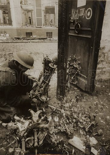 Cambrai, candlesticks tied in bundles, ready from removal by the Germans, but left behind, 1918.  Official photograph.