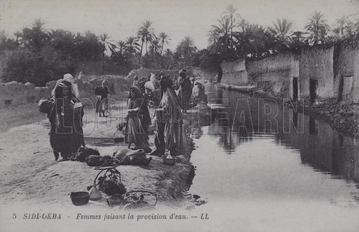Women collecting water in Sidi-Okba, Algeria. Postcard, late 19th or early 20th century;.