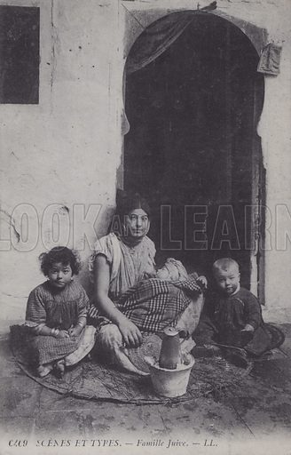 Jewish family outside their home, North Africa. Postcard, late 19th or early 20th century.