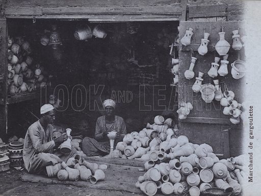 Pottery shopkeeper, North Africa. Postcard, late 19th or early 20th century.