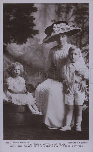 Queen Victoria of Spain (1887-1969) with her children the Prince of the Asturias and Princess Beatrice. Postcard, early 20th Century.