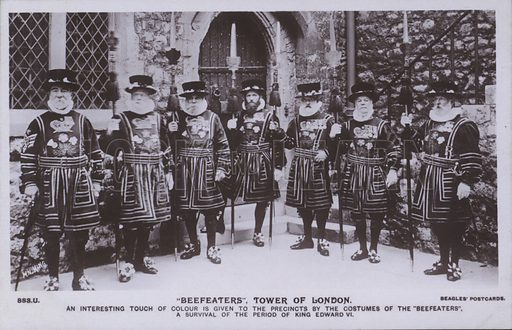 Beefeaters, Tower of London. An interesting touch of colour is given to the precincts by the costumes of the Beefeaters, a survival of the period of King Edward VI.  Postcard, 20th century.