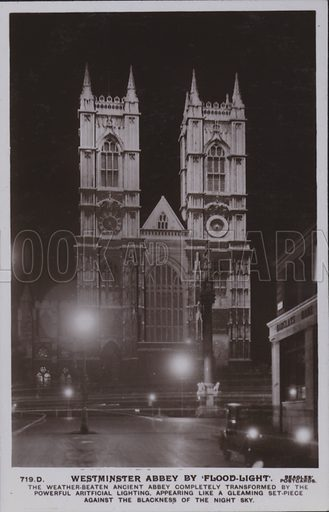 Westminster Abbey by flood-light. The weather-beaten ancient abbey completely transformed by the powerful artificial lighting, appearing like a gleaming set-piece against the blackness of the night sky. Postcard, 20th century.