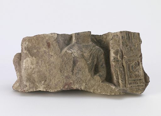 Fragment, showing torso of seated Buddha, a standing Bodhisattva and two cartouches on the front: and left arm of another seated Buddha on the side. Date: 500s. Record ID: fsg_F1911.549.