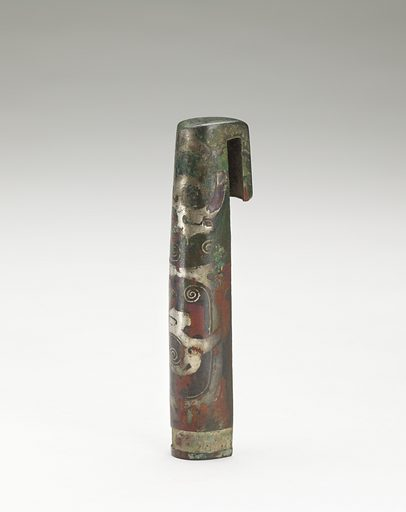 Possibly a handle cover. Date: BCE 0s. Record ID: fsg_F1917.255.