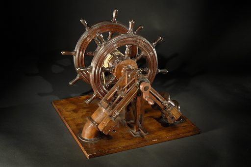 """This patent model accompanied Frederick Ellsworth Sickels' patent application for an """"improvement in modes of steering vessels"""" that was awarded patent number 29,200 on July 17, 1860. """"The principle and character of my invention,"""" Sickels wrote in 1860, """"consists in bringing to the aid of the steersman the power of steam, so arranged as to alternately move and hold the rudder of the vessel in any required position, according to the action of the steersman."""". Date: 1860s. Record ID: nmah_843829."""