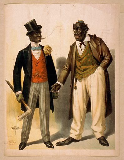 Two performers in blackface, facing each other, one in tuxedo, other in suit. Date c1899.